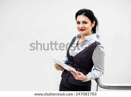 modern businesswoman holding tablet computer with colleague on background - stock photo
