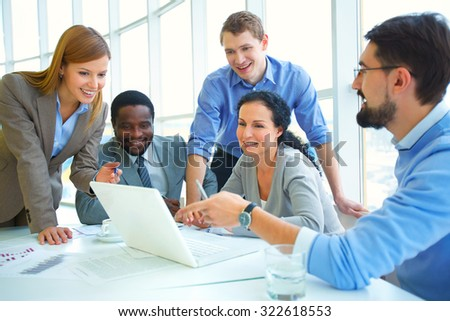 Modern businesswoman making presentation and discussing it with colleagues - stock photo