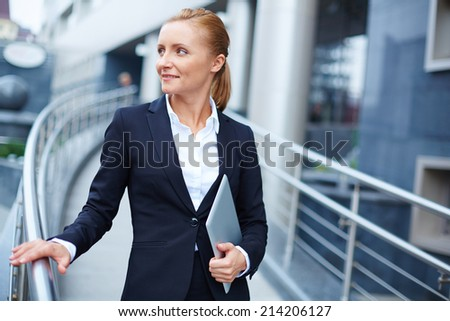 Modern businesswoman with touchpad - stock photo