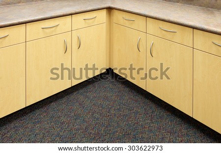 Modern cabinets in a new elementary school.  The cabinets are designed for function and economy. - stock photo