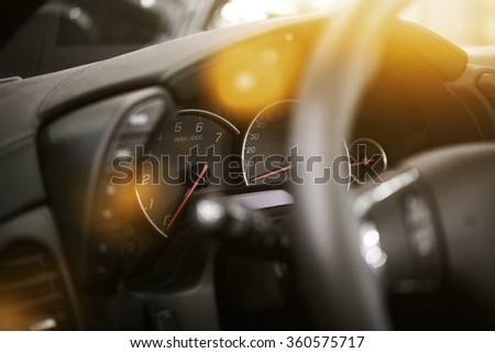 Modern Car Dashboard. Car Driving. Vehicle Steering Wheel and Dashboard. - stock photo