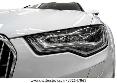 Modern car headlights. Exterior detail. - stock photo
