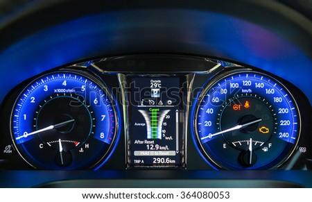 Modern car instrument panel. Blue illuminated display. Car dashboard. - stock photo