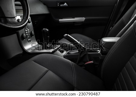 Modern car interior (color toned image; shallow DOF) - stock photo