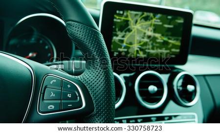 Modern car interior. Shallow DOF. Steering wheel in focus - stock photo