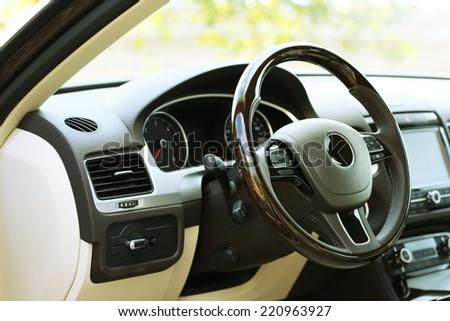 Modern car interior. Steering wheel, close-up - stock photo
