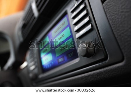 Modern car interior with multifunctional display. Shallow DOF. - stock photo