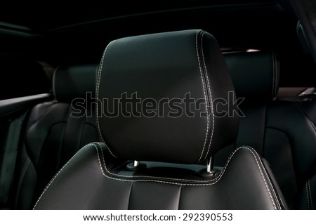 Modern car leather headrest. Interior detail. - stock photo