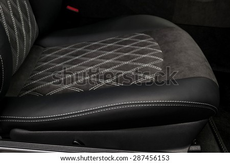 Modern car leather seat. Interior detail. - stock photo