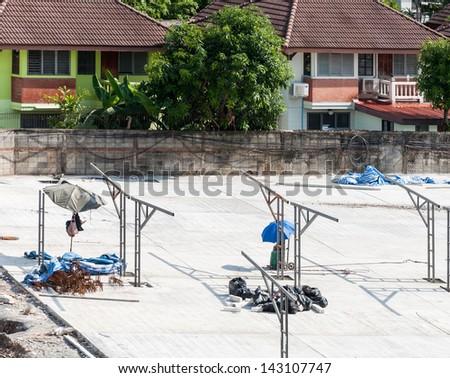 Modern car park is under construction in urban village. - stock photo