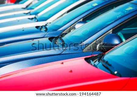 Modern Cars in Stock. Car Dealer Brand New Cars in a Row. - stock photo