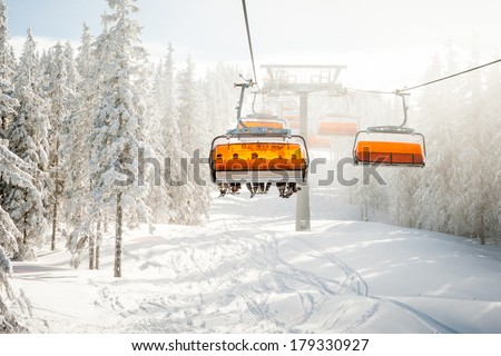 Modern chair ski lift in ski resort in Austria. - stock photo