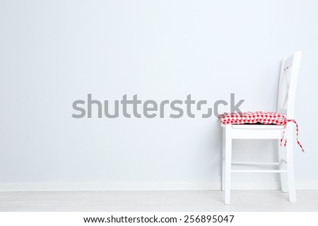 Modern chair with pillow on white wall background - stock photo