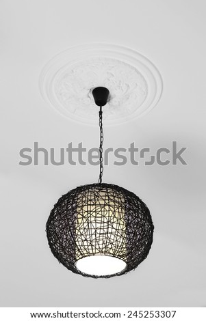 Modern chandelier hanging from ceiling - stock photo