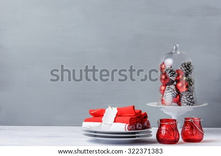 Modern christmas decoration table display in simple, elegant, minimalist style with lots of copy space, glass dome or cloche for xmas ornaments - stock photo