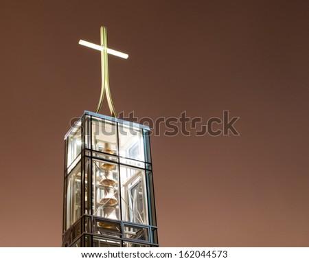 Modern church bell tower at night - stock photo