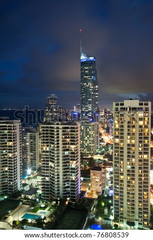 modern city at night viewed from above at vertical format (gold coast, queensland, australia) - stock photo
