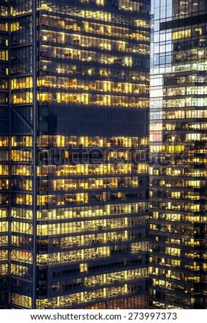 Modern city buildings with lit windows - stock photo