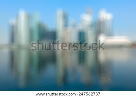 Modern city defocused blurred background - Singapore business district skyscrapers and Marina Bay in day - stock photo