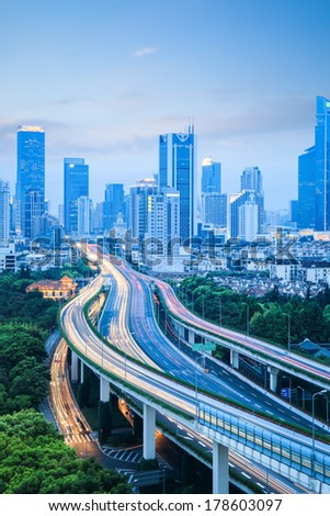modern city elevated road traffic background in shanghai at dusk , China  - stock photo