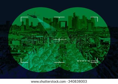 Modern city seen through military binoculars cross-hairs - Conceptual photo. - stock photo