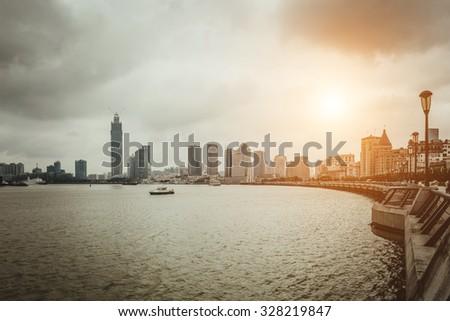 modern city,shanghai skyline in daytime - stock photo