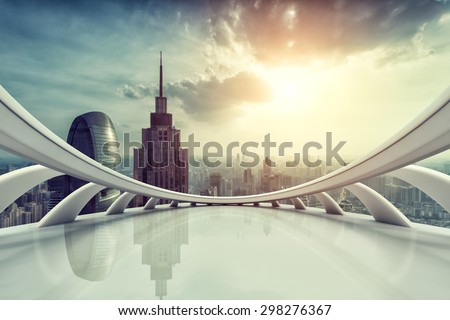 Modern city skyline with empty indoor floor at sunset  - stock photo