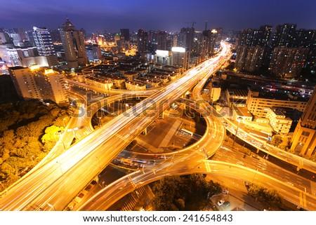 modern city traffic and skyline at night,shanghai. - stock photo