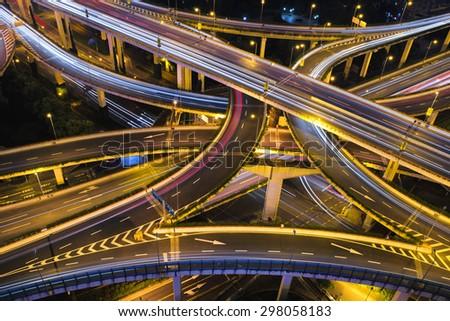 Modern city traffic road at night. Transport road junction. - stock photo