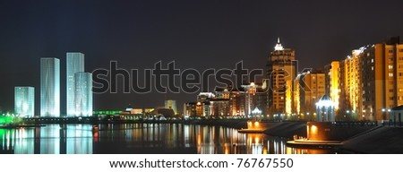 Modern city waterfront by night - stock photo