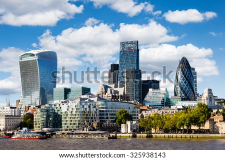 Modern cityscape of London (Europe) with blue sky with white clouds - stock photo