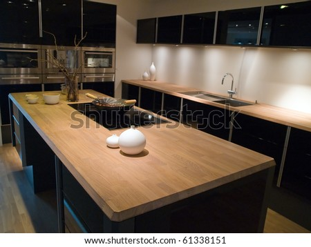 Modern clean design trendy kitchen with black wooden elements - stock photo