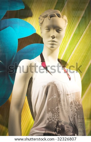Modern clothing shop window with mannequin - stock photo