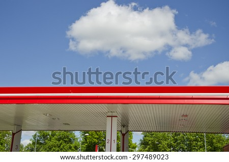 modern colorful gasoline fuel station roof and clouds - stock photo