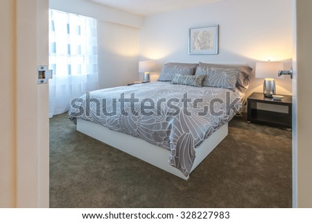 Modern comfortable and elegant luxury master bedroom. Interior design. - stock photo