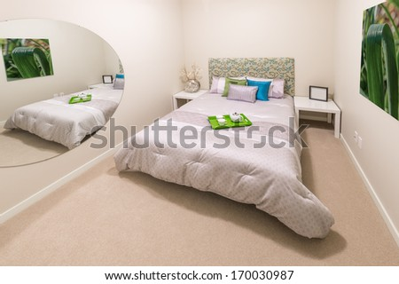 Modern comfortable and elegant luxury master bedroom with the decorative coffee tray and big mirror. Interior design. - stock photo
