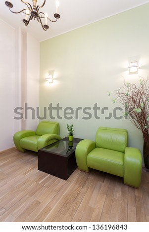 Modern comfortable and green armchair, vertical view - stock photo