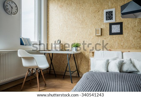 Modern comfortable bedroom with white and black decorations - stock photo