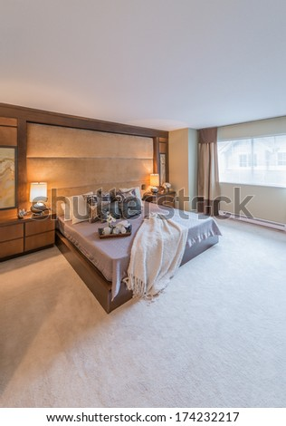 Modern comfortable, cozy, nicely decorated master bedroom. Interior design. Vertical. - stock photo