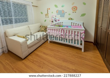 Modern comfortable, nicely decorated children, baby bedroom. Interior design. - stock photo
