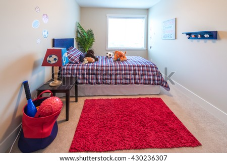 Modern comfortable, nicely decorated children bedroom with some toys. Interior design. - stock photo