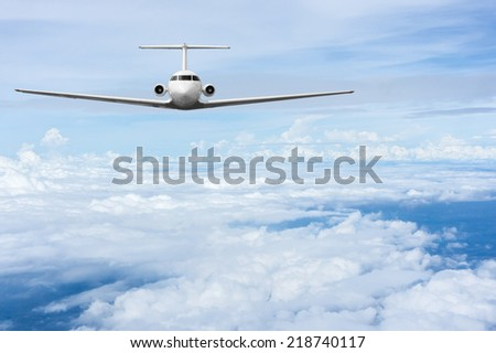 Modern commercial airliner flying high altitude above clouds - stock photo