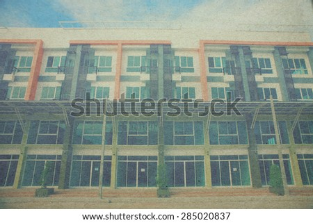 Modern commercial building on a beautiful day paper picture - stock photo