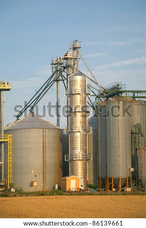 Modern commercial grain or seed silos in rural Prince Edward Island, Canada. - stock photo