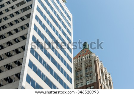 Modern commercial tower and traditional neo-gothic architecture with stunning green and red polychrome tile roof Tulsa, Oklahoma on Route 66. - stock photo