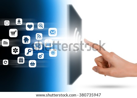 Modern communication technology with human finger touching a screen - stock photo