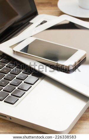 modern computer devices  - laptop, tablet and phone close up - stock photo