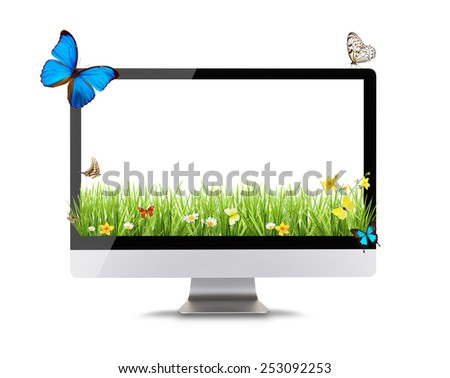 Modern computer display with spring meadow and butterflies. Concept of spring shopping and technology. Front view. Isolated on white background - stock photo