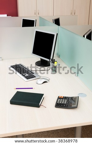 modern computer on a wooden table in the office - stock photo