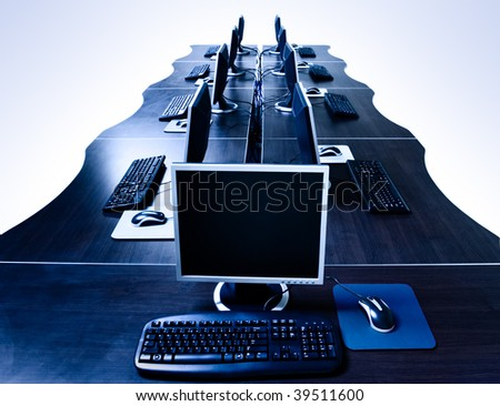 modern computers in IT office isolated with clipping path - stock photo